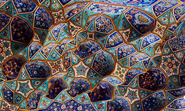 Blue tile patterns, Shah Mosque. Unique blue tiles form an impressive mosaic that  covers the walls of the Shah mosque in Isfahan. The amazing tile patterns Royalty Free Stock Photos