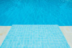 Blue tile in swimming pool Royalty Free Stock Photography