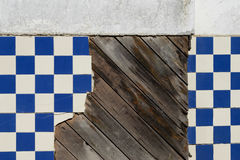 Blue Tile Wall. A decrepit old tile wall of a historic building on the central coast of California stock photos