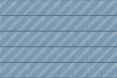 Blue Tiled Background. An abstract illustrated background with a pattern of blue tiles with diagonal stripes Stock Photos