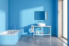 Blue tiled bathroom interior. Blue tiled bathroom with a round sink and a loft window. A concrete floor. A cozy home concept 3d rendering mock up toned image Stock Photos
