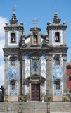 Blue Tiled Church. An historic church in Porto, Portugal with intricate blue and white tile work, sculptures and statues, and bell towers Stock Image