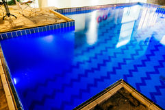 Blue tiled swimming pool Royalty Free Stock Photo