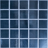 Blue tiles. Close up of dark blue glossy tiled wall Stock Photo