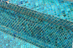 Blue tiles in an abstract pattern. An abstract mosaic of blue tiles. An obvious diagonal runs across the picture Stock Photos