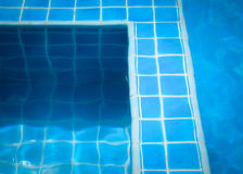 Free Blue Tiles In Swimming Pool Water Stock Photos - 28021213