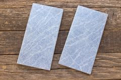 Blue tiles on wooden background Stock Images
