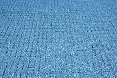 Blue tiles pool  water waves perspective Stock Photo