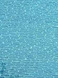 Blue tiles. Swimming pool floor stock image