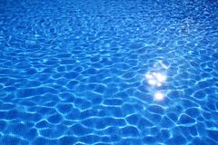 Blue tiles swimming pool water reflection texture Stock Photos