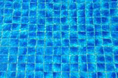 blue tiles swimming pool water reflection Stock Image