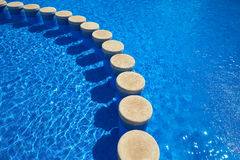 Blue tiles swimming pool water texture Royalty Free Stock Image
