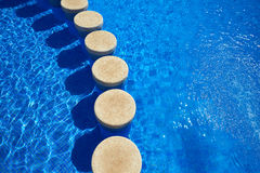 Blue tiles swimming pool water texture Royalty Free Stock Photography