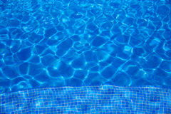 Blue tiles swimming pool water texture Royalty Free Stock Photos