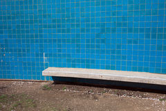 Blue Tiles Wall with Bench Royalty Free Stock Photos