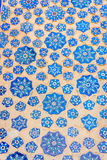 Blue tiles in a wall of Samarkand Registan, Uzbekistan. Blue tiles with ornaments in a wall of Samarkand Registan, Uzbekistan royalty free stock photos