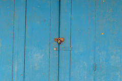 Blue timber door with locked Stock Images
