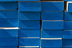 Blue timber ends. Stack of 2x4 boards in a warehouse Royalty Free Stock Photos