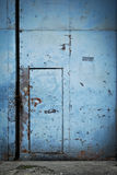 Blue Tin Metal Door on a Gate Royalty Free Stock Photo