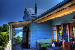 Blue Tin and Timber Cottage Retreat Royalty Free Stock Images