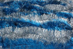 Blue tinsel. New Year's background of blue and white tinsel Stock Photography