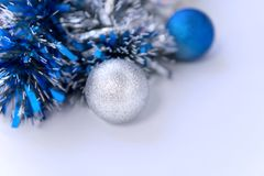 Blue tinsel and Christmas balls royalty free stock photography