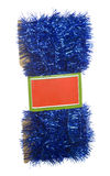 Blue Tinsel Garland with Tag; isolated on white Royalty Free Stock Photo