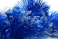 Blue tinsel and silver snowflake Stock Photos