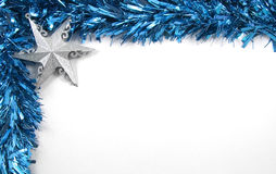 Blue Tinsel and Star Christmas Decorations Stock Photo