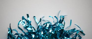 Blue tinsel at white background, glittering and shiny stock image