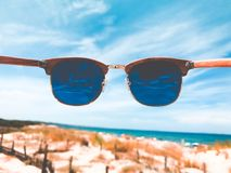 Blue Tint Clubmaster Sunglasses With Brown Frame Royalty Free Stock Photo