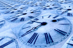 Blue tinted old clock faces. Repeated and tinted blue clock faces at three minutes to nine Royalty Free Stock Photos