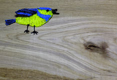 Blue tit draw with 3D printing pen on wooden background. royalty free stock photography