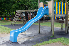 Blue toboggan in the middle of a playground Royalty Free Stock Images