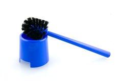 Blue toilet brush. Isolated on white background stock photography