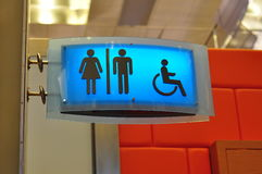 Blue toilet signs. Cool blue male, female and handicap toilet signs Stock Photos