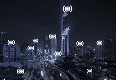 Blue Tone City Scape and Wifi Network Connection. Concept Stock Photos