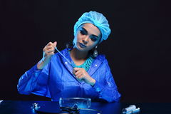 Blue Tone Fashion Scientist in Dark room laboratory with tools l Stock Photos