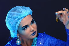 Blue Tone Fashion Scientist in Dark room laboratory with tools l Royalty Free Stock Photography