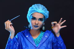 Blue Tone Fashion Scientist in Dark room laboratory with tools l Stock Images