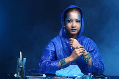 Blue Tone Fashion Scientist in Dark room laboratory with tools l Royalty Free Stock Photo