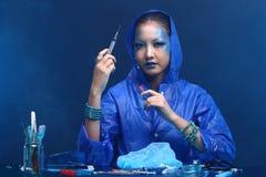 Blue Tone Fashion Scientist in Dark room laboratory with tools l Stock Image