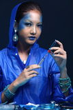 Blue Tone Fashion Scientist in Dark room laboratory with tools l Stock Photography