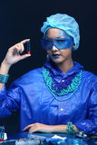 Blue Tone Fashion Scientist in Dark room laboratory with tools l Royalty Free Stock Image