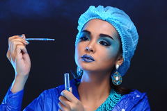 Blue Tone Fashion Scientist in Dark room laboratory with tools l Stock Photo