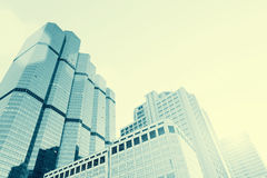 Blue tone of high modern building in business district with free Royalty Free Stock Photography