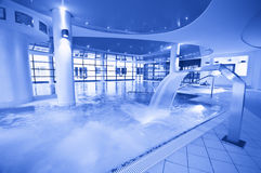 Blue tone swimming pool. General view of indoor swimming pool in blue tone royalty free stock photo
