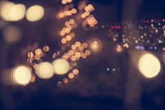 Blue toned blurred Christmas background with street lights on the night street in vintage style Stock Photography