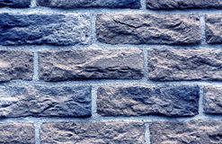Blue toned brick wall surface. Stock Photos