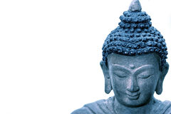 Blue toned Buddha. isolated on white. Stock Photo